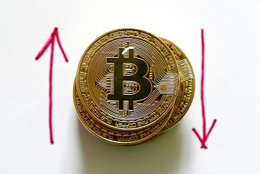 Bitcoin stack up and down arrows