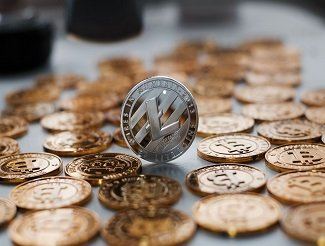 Digital currency metal litecoin coin on the gold bitcoins.