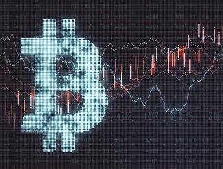 Bitcoin symbol against stock market graphs