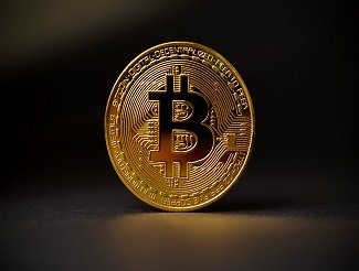 bitcoin metal coin crypto currency on black background