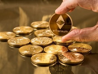 Hand holding an ethereum coin
